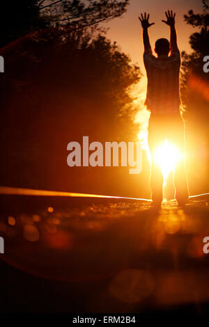 Man on railroad tracks at sunset in Wilmington, North Carolina. - Stock Photo