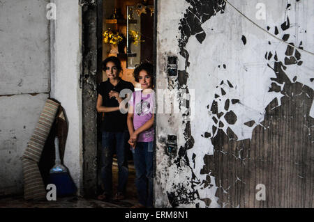 Damascus, Syria. 3rd June, 2015. Two sisters stand in their house in the conflict-stricken town of Aqraba, Damascus, - Stock Photo