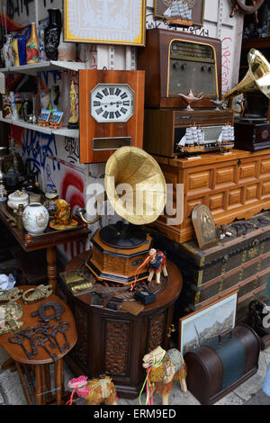An antique store with a display of objects and furniture Chased