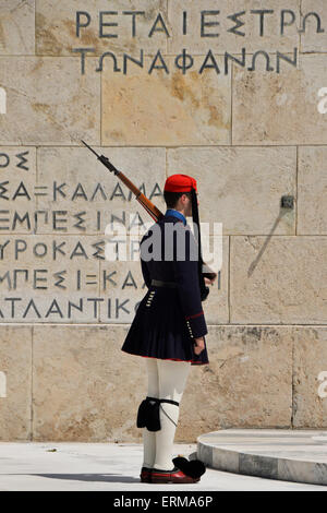 Evzone soldier with bayonet in traditional uniform at the tomb of the unknown soldier. - Stock Photo