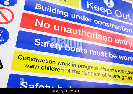 A safety warning sign on the outside of a construction site in Bristol. - Stock Photo