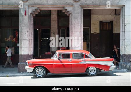 HAVANA, CUBA - JUNE, 2011: Vintage American car serving as taxi drives along a street in Central Havana. - Stock Photo