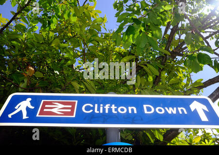 A footpath sign directing pedestrians to Clifton Down railway station in Bristol. - Stock Photo