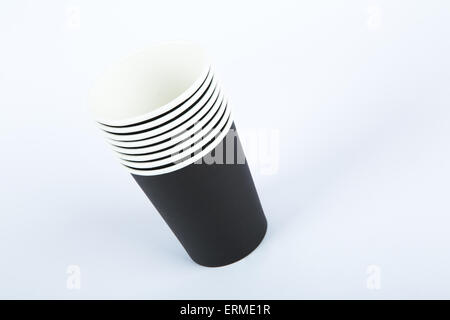 Close up front view of recycled black paper glasses on end, isolated on white background. - Stock Photo