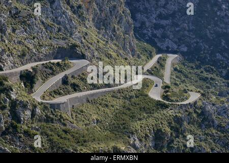 Serpentine road in the bay of Sa Calobra, Majorca, Balearic Islands, Spain - Stock Photo