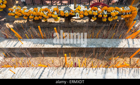 Incense and candles in a temple, Bangkok, Thailand - Stock Photo