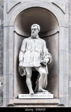 Statue of Benvenuto Cellini in Uffizi gallery, seen in Lungarno degli Archibusieri street. Florence, Italy. - Stock Photo