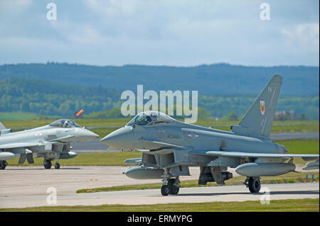 Eurofighter Typhoon fast fighter jet preparing to take off from RAF Lossiemouth home base in Scotland.  SCO 9853. - Stock Photo