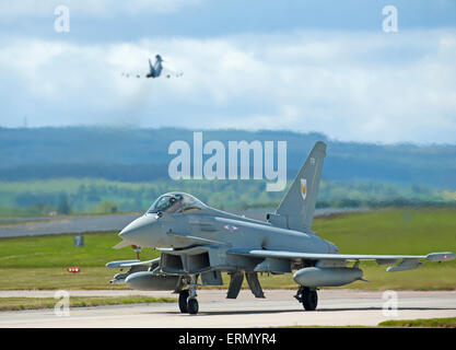 Eurofighter Typhoon fast fighter jet preparing to take off from RAF Lossiemouth home base in Scotland.  SCO 9854. - Stock Photo