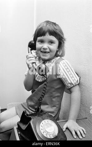 Six year old Jayne Myers receives her weekly phone call from Five year old boyfriend Andrew Butler who calls her - Stock Photo