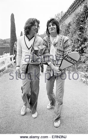 Mick Jagger and Ron Wood, takes time out to relax in the South of France, by playing tennis, before the start of - Stock Photo