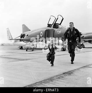 Phantom pilot Lieutenant Commander Peter Marshall of the Fleet Air arm, with his four year old son Richard dressed - Stock Photo