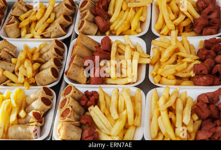 Fried food such as wieners and fries for sale at a stand; Puerto Vallarta, Jalisco, Mexico - Stock Photo