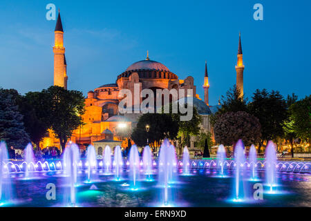 Night view of fountain light show with Hagia Sophia behind, Sultanahmet, Istanbul, Turkey - Stock Photo
