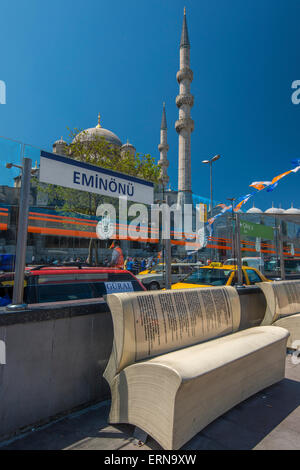 Open book shape bench at Eminonu tram station with Yeni Cami or New Mosque behind, Istanbul, Turkey - Stock Photo