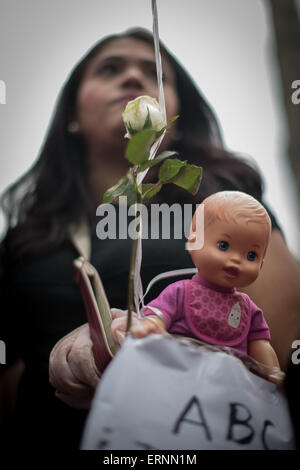 Mexico City, Mexico. 5th June, 2015. A woman takes part in a march in commemoration of the 6th anniversary of the - Stock Photo