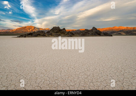 The dry lake and mountains on a sunset, Racetrack Playa,  Death Valley, California USA - Stock Photo