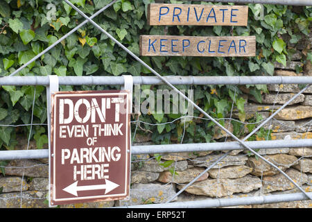 Information Signs for Private road  'Don't even think of Parking here' - Stock Photo