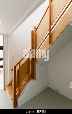 Detail of interior wooden staircase to flat on the Alexandra and Ainsworth estate in Camden, North West London. - Stock Photo