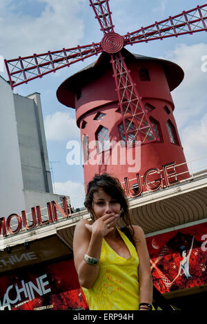A girl sending a kiss at famous Moulin Rouge cabaret & night club in Paris, France - Stock Photo