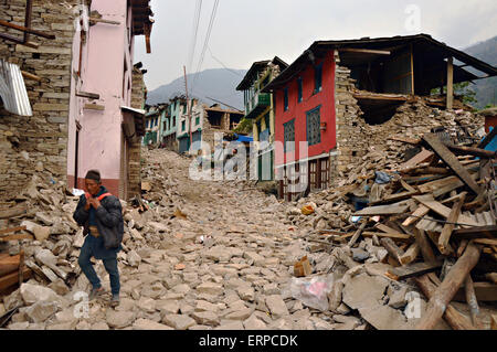 A Nepali man walks through the ruins of his village May 7, 2015 in Sindhupalchok, Nepal. The devastating earthquakes - Stock Photo