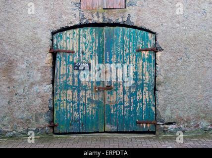 Garage door in wall, UK - Stock Photo