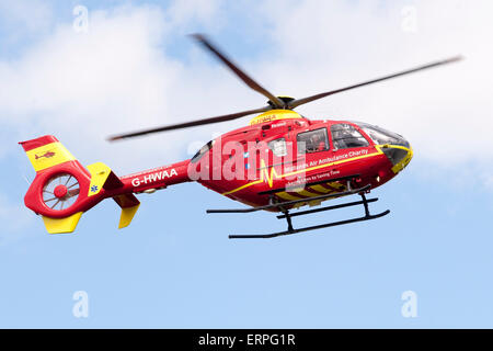 Eurocopter EC135T2 G-HWAA operated by the Midlands Air Ambulance Charity approaches for landing at Throckmorton - Stock Photo