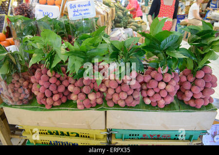 Fresh lychees at the fancy Or Tor Kor farmer's market in Bangkok, Thailand - Stock Photo