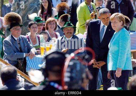 U.S. President Barack Obama talks to German Chancellor Angela Merkel, right, during a joint walk through the village of Kruen, southern Germany, Sunday, June 7, 2015 prior to the G-7 summit in Schloss Elmau hotel near Garmisch-Partenkirchen where the summit will start later the day. Photo: Matthias Schrader dpa