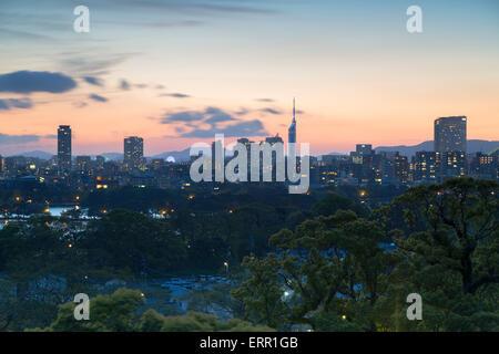 Coastal area skyline at sunset, Fukuoka, Kyushu, Japan - Stock Photo