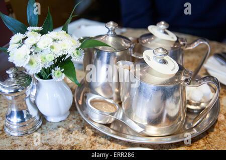 Tea silverware on a table (at Betty's Tea Room in York, England) - Stock Photo