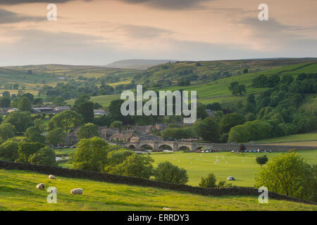 Rural idyll - sunny summer evening view of beautiful, scenic, hilly countryside & village cricket match - Burnsall, - Stock Photo