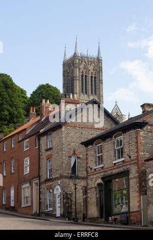 Steep Hill, Lincoln, with cathedral tower in the background. - Stock Photo
