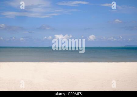 Minimalist image of a tropical beach, sky, sand and sea - Stock Photo