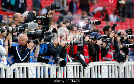 Professional Photographers working at a sports event. - Stock Photo