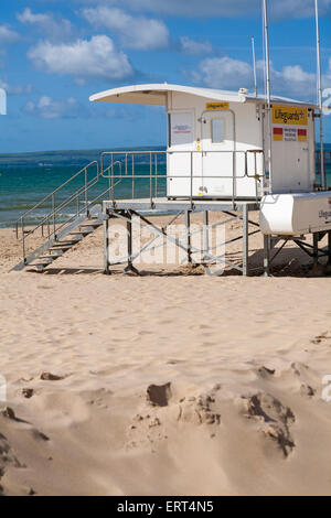 RNLI lifeguards kiosk on a sunny day at Alum Chine beach, Bournemouth in June - Stock Photo