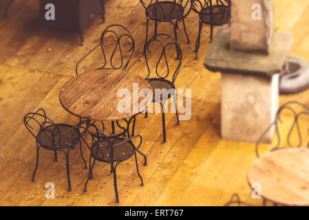 Empty Street Cafe Chairs and Tables on Terrace after the Sudden Summer Rain - Stock Photo