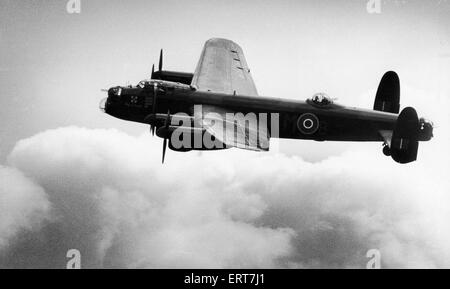 The last serving Royal Air Force Avro Lancaster bomber makes its first flight since being grounded two years ago - Stock Photo