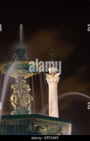 Fountain and statue in Rossio or Pedro IV Square, Lisbon Portugal - Stock Photo