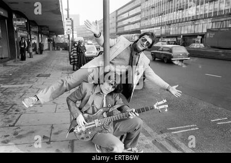 Guitarist Gerry Cott (standing) and bass player Peter Briquette from the Boomtown Rats visited Birmingham to make - Stock Photo