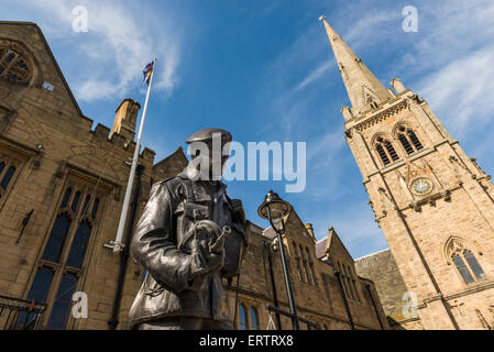 Memorial sculpture to the Durham Light Infantry, front of St Nicholas Church, Durham, England, UK - Stock Photo