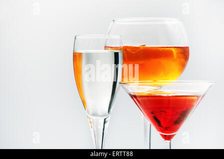 Assorted alcoholic cocktails in different shaped glasses - Stock Photo