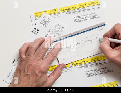 Man writing check to Internal revenue service IRS form 1040-ES for ...