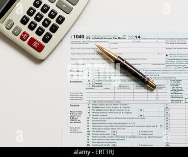 2014 Irs Form 1040 With Calculator And Pen Stock Photo 78023308 Alamy