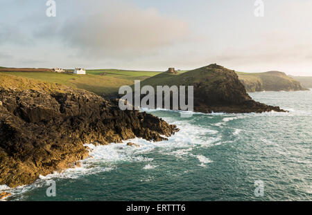 Doyden Castle on the cliffs at Port Quin near Port Issac, Atlantic coast, North Cornwall, UK in the late afternoon - Stock Photo
