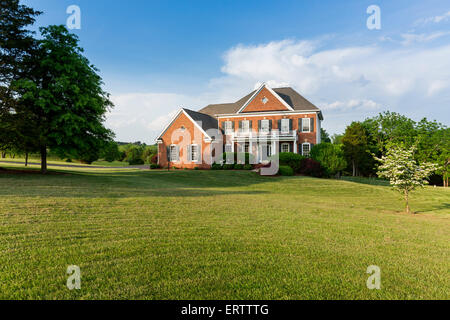 Detached house USA - Front of large single American family home with large garden lawn on a warm sunny summer day - Stock Photo
