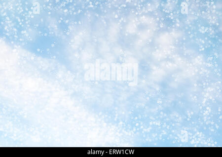 Falling snowflakes on  blue background - Stock Photo