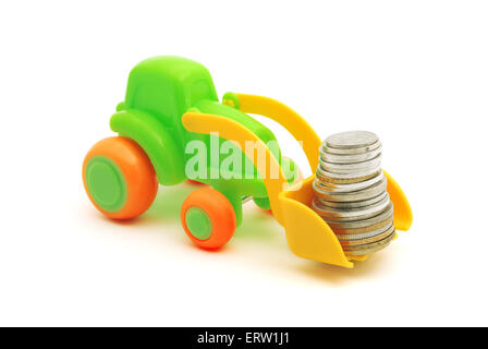 The toy excavator loads money on white background - Stock Photo