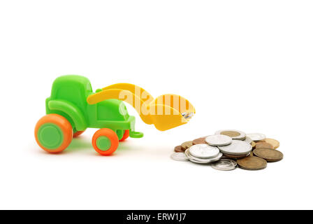 The toy excavator loads money on white background - Stock Photo