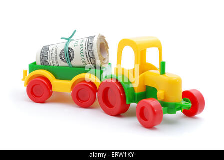 The toy tractor transortation money on white background - Stock Photo
